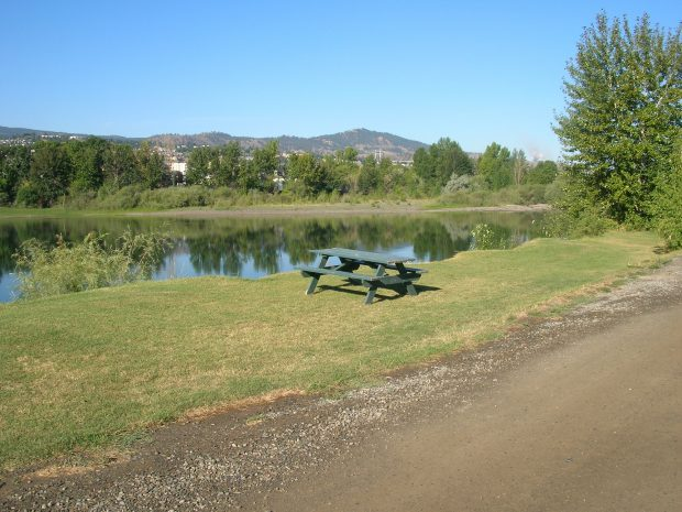 A picnic bench by the lake at Silver Sage Campground in Kamloops.