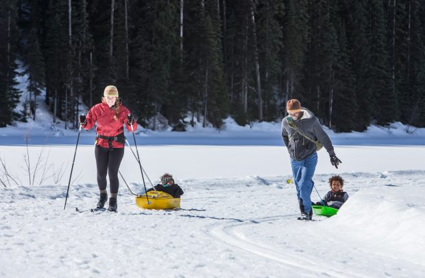 A family, cross-country skiing in winter at Manning Park.